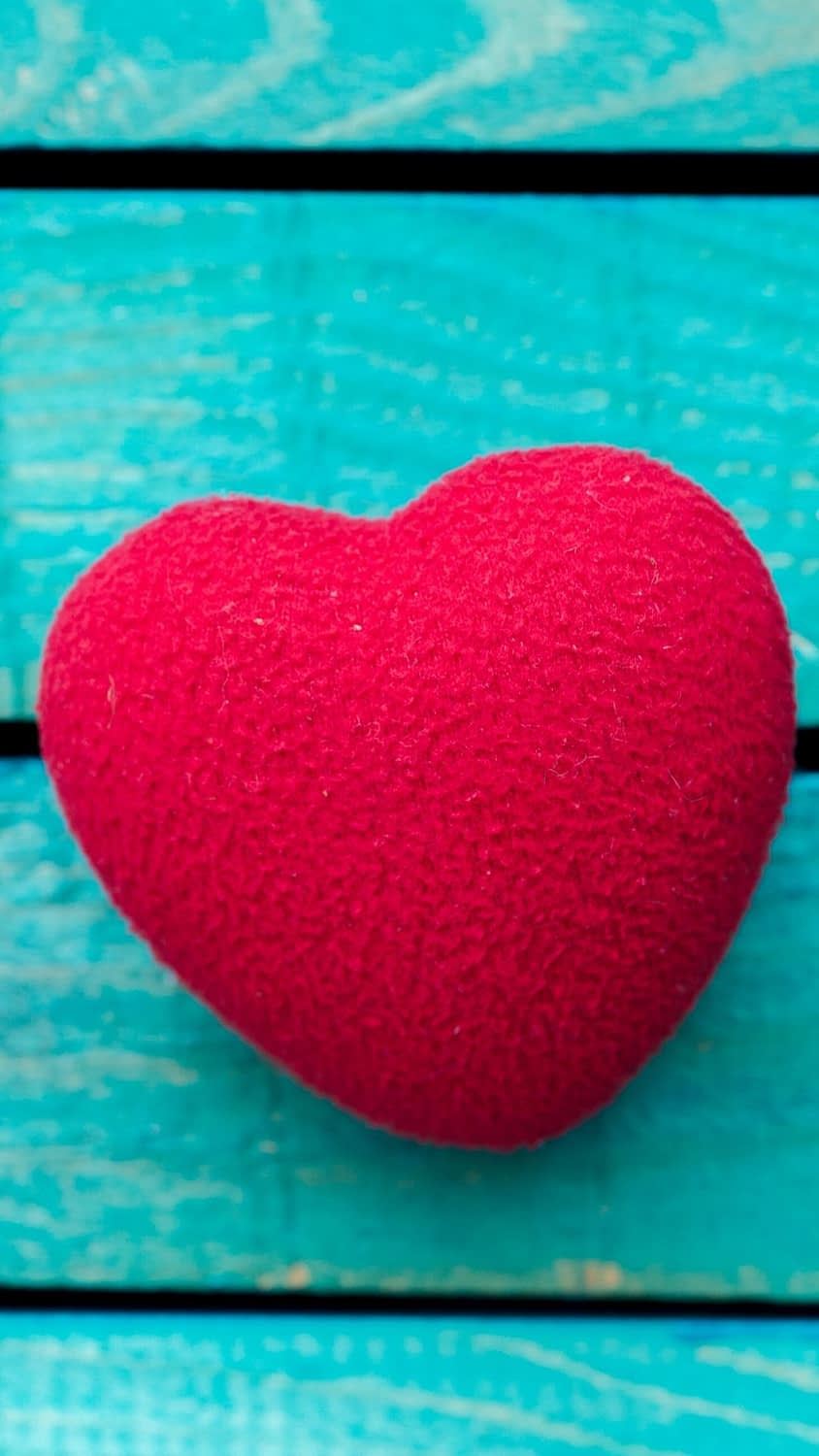 Teal background with a Heart for Valentines Day Iphone Wallpaper