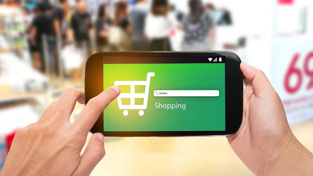 Green screen on a mobile phone with a search bar and a shopping cart