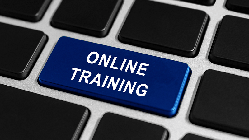 blue online training button on keyboard