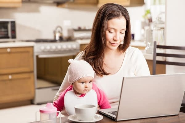 Mom and baby are doing business at a computeer