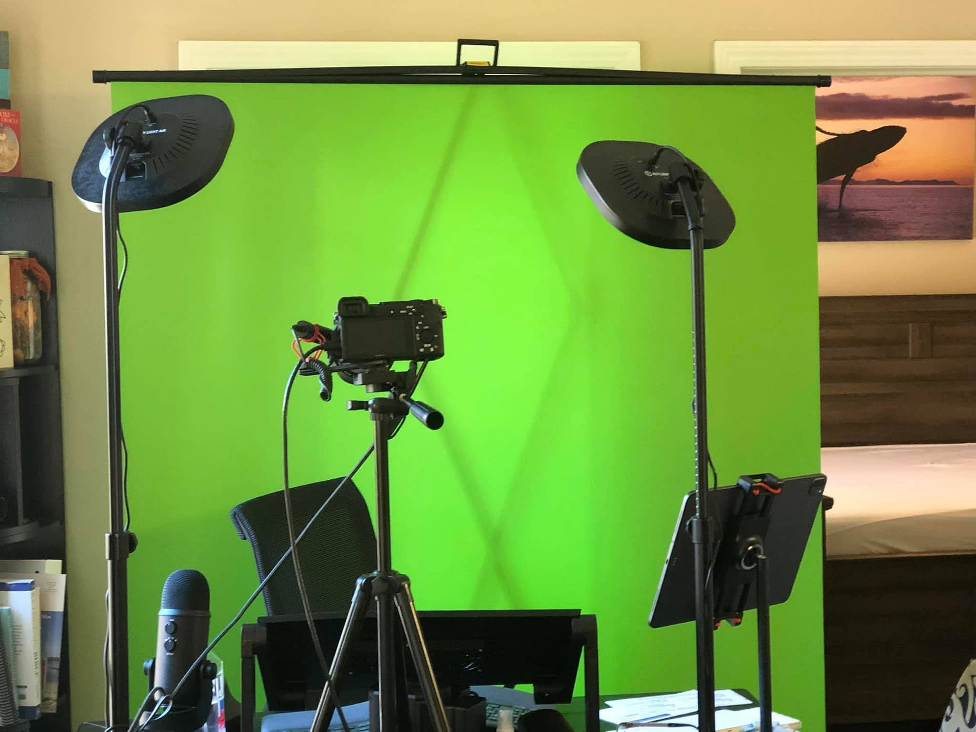 youtube studio with greenscreen, keylights, video camera, recording equipment
