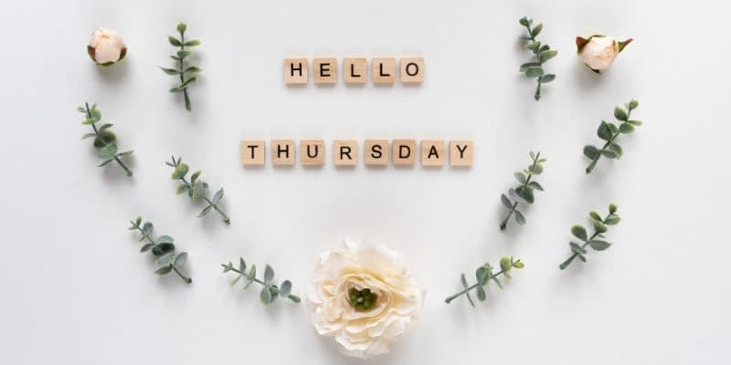 The words Hello and Thursday are spelled out with scrabble tiles